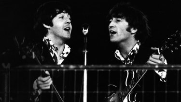 Paul McCartney and John Lennon during the last Beatles concert at Candlestick Park on August 29, 1966.