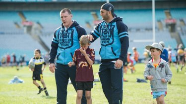 Kings of the kids: Paul Gallen and Robbie Farah at an NRL skills clinic at ANZ Stadium on Monday.