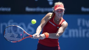 Feeling the heat: Germany's Angelique Kerber defied the conditions in Sydney to win her first-round match against Elina Svitolina.