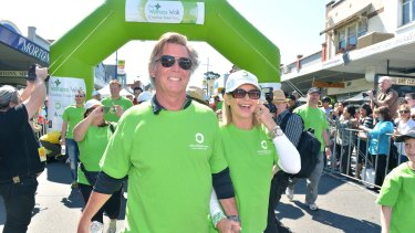 Olivia Newton-John with her husband John Easterling at the start of Melbourne's annual Wellness Walk to help raise money for programs at the Olivia Newton-John Cancer Wellness & Research Centre.