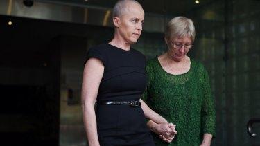 Ashley Bryant's widow Deborah, left, leaves the NSW Coroner's Court in Glebe on Wednesday.