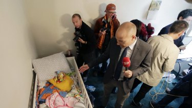 Members of the media crowd into a child's room in an apartment in Redlands, California, shared by San Bernardino terrorists Syed Farook and his wife, Tashfeen Malik.