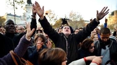 Members of the public pay tribute to the victims at the Place de la Republique.
