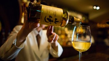 A bartender pours Yamazaki whisky at the Hibiya whisky bar in the Ginza district in Tokyo.