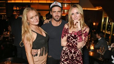 Olivia Cooney, Spencer Matthews and Kimberley Garner attend a celebrity event in London.