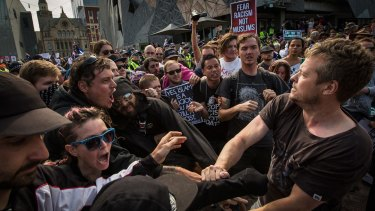 Rally against racism protesters clash with Reclaim Australia protesters at Federation Square on April 4.