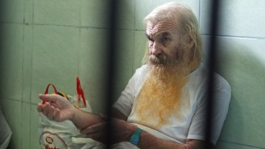 Australian Robert Andrew Fiddes Ellis sits in a cell at the Prosecutors Office in Bali, Indonesia.