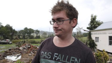 Keegan Taylor at the site of his house, which was washed away by flood waters in Dungog.