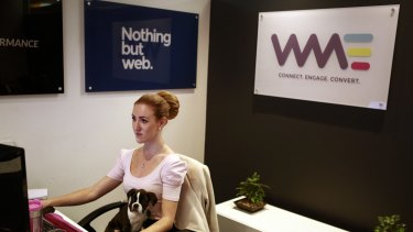 "Allana Burns, receptionist with Trinity at WME Group, a digital marketing agency, on its ""bring your dog to work day"" on May 13."