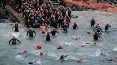 They're off: Lorne Pier to Pub competitors take to the water.