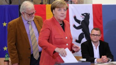 Germany's chancellor Angela Merkel, the Christian Democratic Union party leader, casts her vote in Berlin Sunday.
