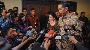 Too busy to talk: Indonesian President Joko Widodo.