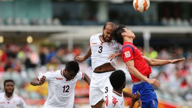 Heads up: Jaber Al Owaisi of Oman and Koo Ja Cheol of South Korea contest a high ball at Canberra Stadium on Saturday.