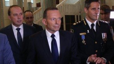 Immigration Minister Peter Dutton, Prime Minister Tony Abbott and Australian Border Force commissioner Roman Quaedvlieg.