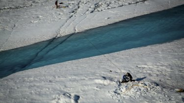 A rope-and-pulley system set up across a river flowing from a supraglacial lake and into a giant hole in the ice, called a moulin, near the researchers' camp in July.