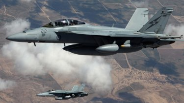 An Australian F/A-18F Super Hornet and an F/A-18A Hornet patrol the skies over Iraq.