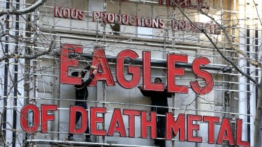 Workers set up ahead a Tuesday's concert by Eagles of Death Metal, at the Olympia music hall, in Paris. Survivors of November's deadly Paris attacks have opened up to a French terrorism commission ahead of a highly charged concert in the French capital.