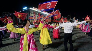 Men and women participate in a mass dance event in October marking the 20th anniversary of former leader Kim Jong-iI's election.