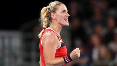 Timea Babos of Hungary reacts against Coco Vandeweghe of the United States.