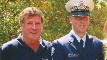 Michael Maynes, pictured with his father Robert Maynes, on his graduation day from Victoria Police.
