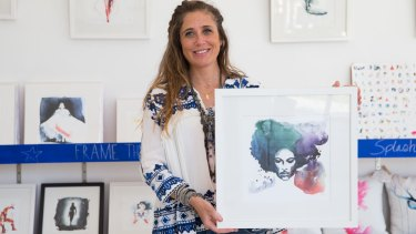 Artist Clementine Campardou with the portrait that Prince bought.