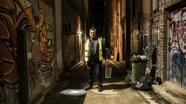 Pest controller David Gay at work in one of Melbourne's laneways.