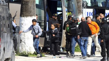 Tourists and visitors from the Bardo museum are evacuated in Tunis after gunmen opened fire.