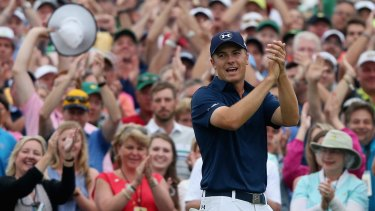 Jordan Spieth celebrates on the 18th green after his victory.