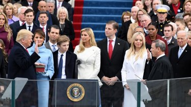 Donald Trump's closest friend, Thomas Barrack jnr, pictured back left with blue scarf at the presidential inauguration, tells Trump when he is wrong.