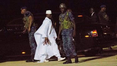 Yahya Jammeh (in white) heads for exile at Banjul airport.