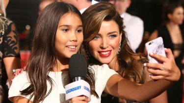 Dannii Minogue poses for a selfie with Stella Klim, Michael and Lindy Klim's daughter, at the Logies in May.