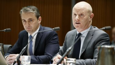 Commonwealth Bank chief executive Ian Narev (right), and Matt Comyn, retail banking services group executive, during the hearing.