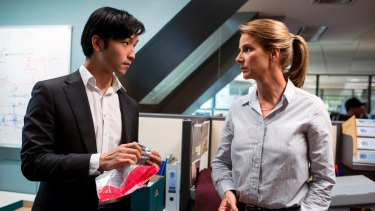 Yoson An as Charlie Fung and Rachel Griffiths as Grace Gibbs in <i>Dead Lucky</i>.