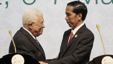 Indonesian President Joko Widodo, right, shakes hands with Palestinian Authority President Mahmoud Abbas at an extraordinary summit of Muslim countries on Palestine and the status of Jerusalem in Jakarta in March.