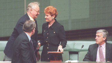 Senator Hanson is congratulated after her 1996 maiden speech in which she said Australia was in danger of being swamped by Asians.