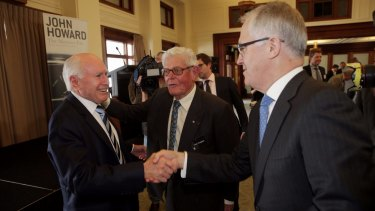 Former Menzies minister Tom Hughes (centre), who gave the Sir Garfield Barwick address in 2011, with his son-in-law, Communications Minister Malcolm Turnbull (right) and former Liberal prime minister John Howard.