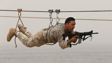 A Lebanese commando demonstrates his skills during an exhibition at the Security Middle East Shows in Beirut this month. Saudi Arabia has pledged billions of dollars in assistance to Lebanon's military and intelligence services.