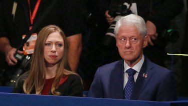Former President Bill Clinton, with daughter Chelsea, looked uneasy throughout the debate.