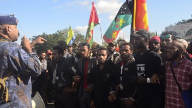 Student protesters in Papua New Guinea in a stand off with police.