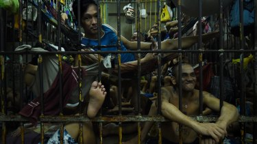 Prisoners incarcerated as part of Duterte's unprecedented crackdown on illegal drugs crowd a cell in the Manila Police Headquarters.
