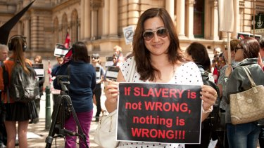 Protestors rally against slavery of migrant workers in Qatar in Sydney in 2013.