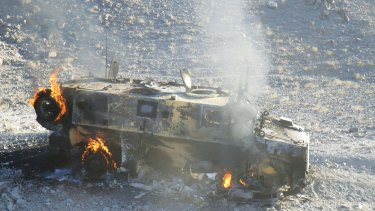 A Coalition vehicle after being hit by an improvised explosive device.