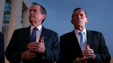 Opposition Leader Bill Shorten and Prime Minister Tony Abbott during a candlelight vigil for Andrew Chan and Myuran Sukumaran at Parliament House on Thursday.