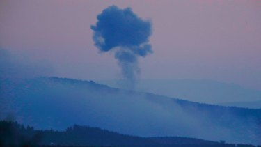 Plumes of smoke rise from inside Syria, as seen from the outskirts of the border town of Kilis, Turkey.