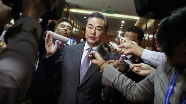 Chinese Foreign Minister Wang Yi is surrounded by journalists at the Association of Southeast Asian Nations (ASEAN) Foreign Ministers Meeting in Kuala Lumpur on Tuesday.
