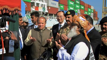 Pakistani Prime Minister Nawaz Sharif, centre left, prays near Chinese Ambassador to Pakistan Sun Weidong, centre, after inaugurating a new international trade route during a ceremony at the Gwadar port.