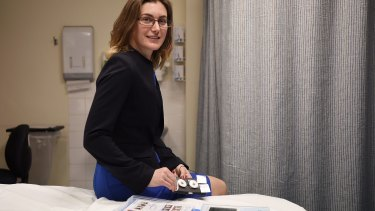 PhD Candidate Sarah McDonald, who is working with the RPA Women and Babies team, holds a proof-of-concept device for patches that will monitor pregnancy and labour progression.
