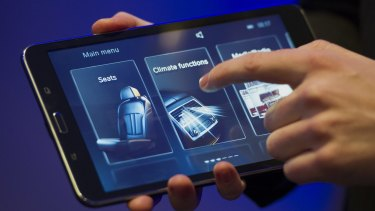 BMW shows off its suite of climate, entertainment and car functionality controls on a Samsung tablet at CES 2015.