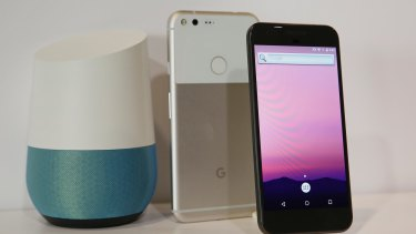 The new Google Pixel phone is displayed next to a Google Home smart speaker.