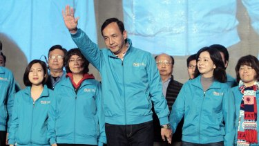 Taiwan's ruling Nationalist candidate Eric Chu, front center, waves to supporters as he concedes defeat.